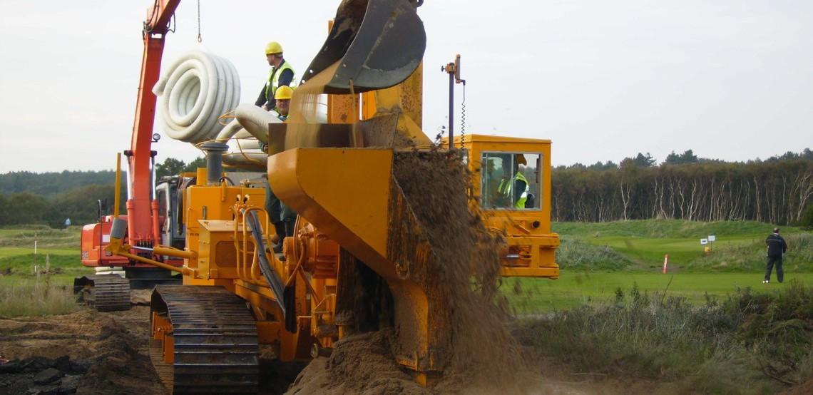 Trenching Machines Working : Deep trenching machine mastenbroek limited